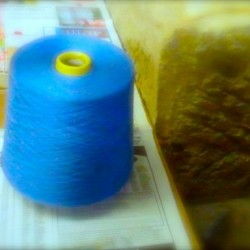 a large roll of 32 blue thread